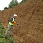 A geoscientist from Halliburton examines the Red Gravels during a joint trip with OGT on 17th Sept 2017